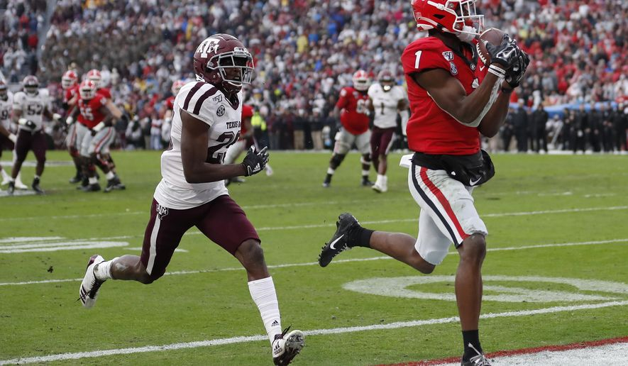Georgia wide receiver George Pickens (1) makes a catch for a touchdown as Texas A&M defensive back Debione Renfro (29) defends in the first half of an NCAA college football game Saturday, Nov. 23, 2019, in Athens, Ga. (AP Photo/John Bazemore)