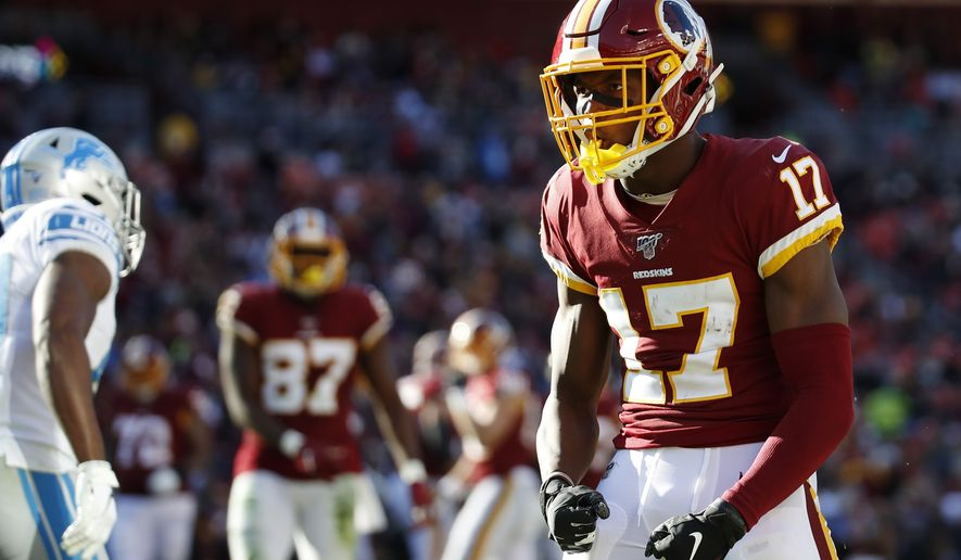 Washington Redskins wide receiver Terry McLaurin (17) reacts after catching a pass from quarterback Dwayne Haskins, not visible, during the first half of an NFL football game against the Detroit Lions, Sunday, Nov. 24, 2019, in Landover, Md. (AP Photo/Alex Brandon)