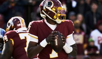 Washington Redskins quarterback Dwayne Haskins (center) drops back to pass during an NFL football game against the Detroit Lions, Sunday, Nov. 24, 2019, in Landover, Md. (AP Photo/Mark Tenally)