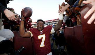 Washington Redskins quarterback Dwayne Haskins runs off the field after an NFL football game against the Detroit Lions, Sunday, Nov. 24, 2019, in Landover, Md. The Redskins won 19-16. (AP Photo/Alex Brandon)