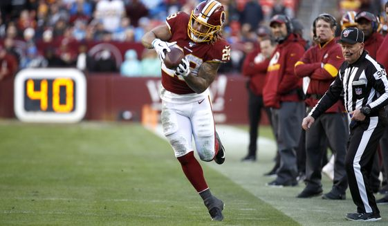 Washington Redskins running back Derrius Guice makes a catch against the Detroit Lions during the second half of an NFL football game, Sunday, Nov. 24, 2019, in Landover, Md. The Redskins won 19-16. (AP Photo/Patrick Semansky)