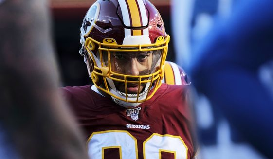 Washington Redskins linebacker Montez Sweat looks across the line of scrimmage during an NFL football game against the Detroit Lions, Sunday, Nov. 24, 2019, in Landover, Md. (AP Photo/Mark Tenally)