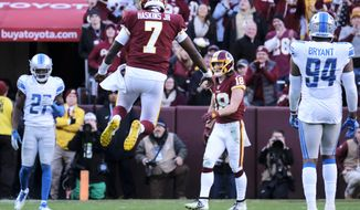 Washington Redskins quarterback Dwayne Haskins (7) celebrates a first down in the last two minutes of an NFL football game between the Detroit Lions and Washington Redskins, Sunday, Nov. 24, 2019, in Landover, Md. (AP Photo/Mark Tenally)