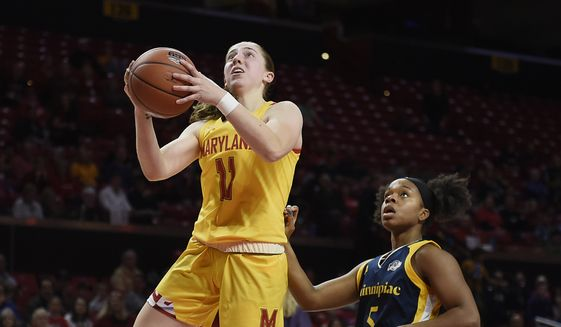 Maryland's Taylor Mikesell, left, shoots a layup as Quinnipiac's Shaq Edwards looks on during an NCAA college basketball game on Sunday, Nov. 24, 2019, in College Park, Md. (AP Photo/Gail Burton)  **FILE**