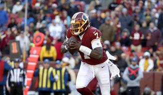 Washington Redskins quarterback Dwayne Haskins looks to pass against the Detroit Lions during the second half of an NFL football game, Sunday, Nov. 24, 2019, in Landover, Md. (AP Photo/Alex Brandon)