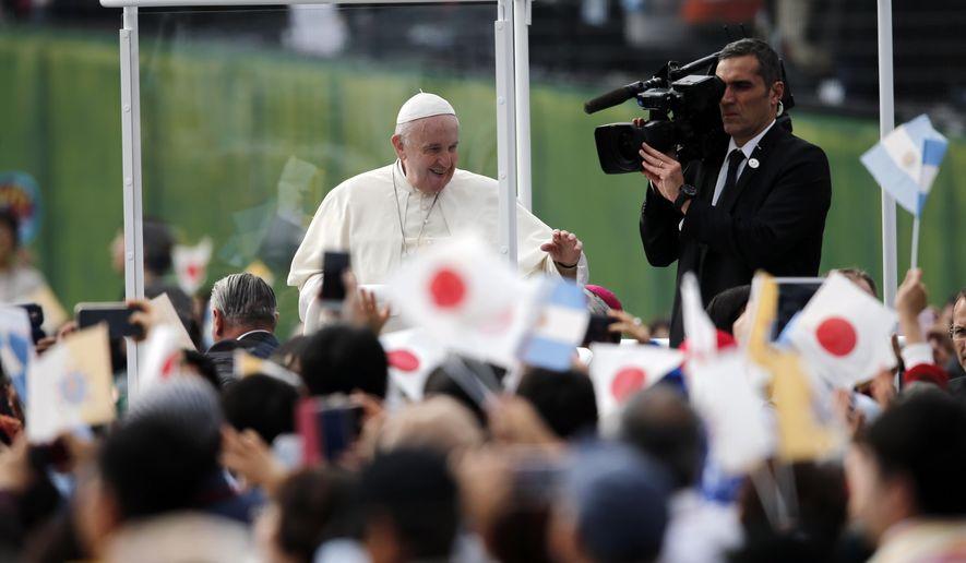 Pope Francis waves in his popemobile as he celebrates a Mass at Nagasaki Prefectural Baseball Stadium, Sunday, Nov. 24, 2019, in Nagasaki, Japan. (AP Photo/Kiichiro Sato)