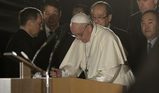 Pope Francis signs a visitors' book at Hiroshima Peace Memorial Park for a meeting in Hiroshima, western Japan, Sunday, Nov. 24, 2019. (AP Photo/Gregorio Borgia)