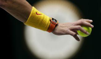Spain's Rafael Nadal prepares to serve to Great Britain's Jamie Murray and Neal Skupski during their Davis Cup semifinal doubles match in Madrid, Spain, Saturday, Nov. 23, 2019. (AP Photo/Bernat Armangue)