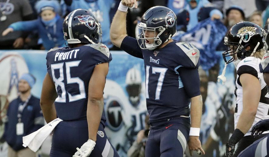 Tennessee Titans quarterback Ryan Tannehill (17) celebrates with tight end MyCole Pruitt (85) after Tannehill ran for a touchdown against the Jacksonville Jaguars in the first half of an NFL football game Sunday, Nov. 24, 2019, in Nashville, Tenn. (AP Photo/James Kenney)