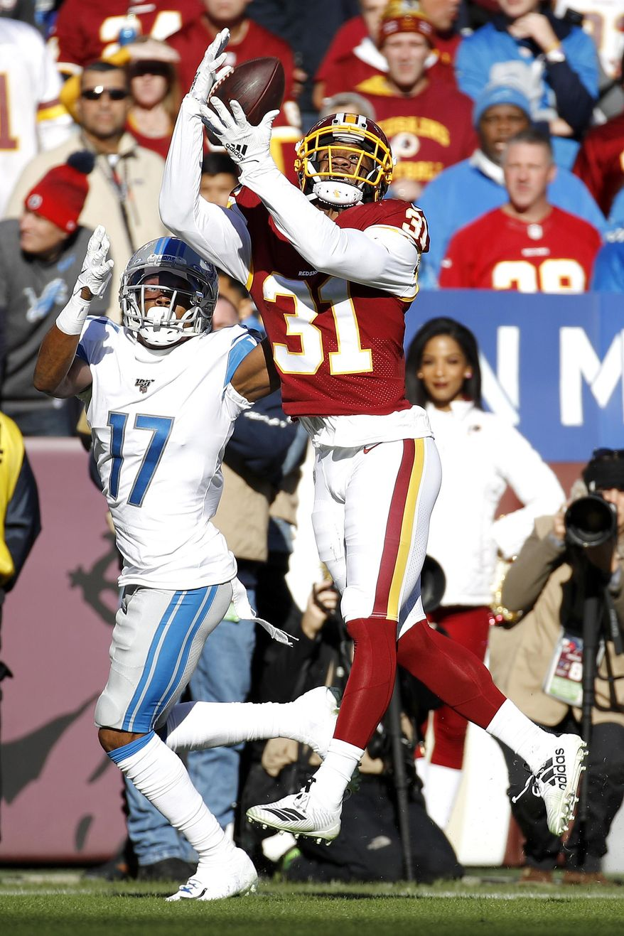 Washington Redskins cornerback Fabian Moreau (31) intercepts a pass from Detroit Lions quarterback Jeff Driskel, not visible, intended for wide receiver Marvin Hall (17) during the first half of an NFL football game, Sunday, Nov. 24, 2019, in Landover, Md. (AP Photo/Patrick Semansky) **FILE**