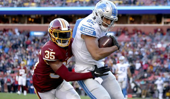 Detroit Lions tight end Logan Thomas (82) scores a touchdown on a pass from quarterback Jeff Driskel, not visible, as Washington Redskins free safety Montae Nicholson (35) tries to bring him down in the end zone during the second half of an NFL football game, Sunday, Nov. 24, 2019, in Landover, Md. (AP Photo/Alex Brandon) ** FILE **