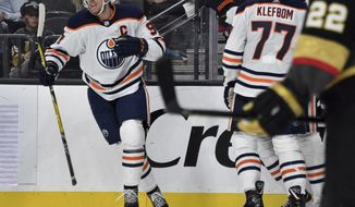 Edmonton Oilers center Connor McDavid (97) celebrates his goal against the Vegas Golden Knights during the third period of an NHL hockey game Saturday, Nov. 23, 2019, in Las Vegas. (AP Photo/David Becker)