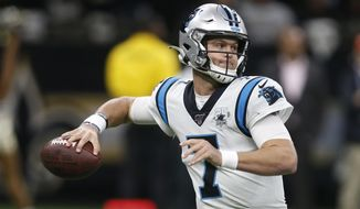 Carolina Panthers quarterback Kyle Allen (7) looks to pass, during the first half at an NFL football game against the New Orleans Saints, Sunday, Nov. 24, 2019, in New Orleans. (AP Photo/Butch Dill)
