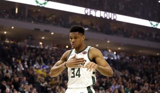 Milwaukee Bucks' Giannis Antetokounmpo reacts at the start of an NBA basketball game against the Detroit Pistons during the first half Saturday, Nov. 23, 2019, in Milwaukee. (AP Photo/Jeffrey Phelps)