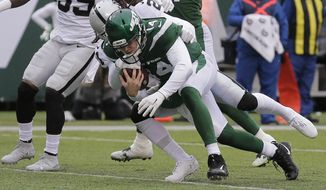 New York Jets quarterback Sam Darnold (14) runs past Oakland Raiders' D.J. Swearinger (21) for a touchdown during the first half of an NFL football game Sunday, Nov. 24, 2019, in East Rutherford, N.J. (AP Photo/Seth Wenig)