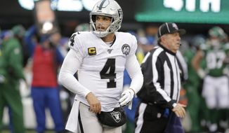 Oakland Raiders quarterback Derek Carr reacts during the second half of an NFL football game against the New York Jets, Sunday, Nov. 24, 2019, in East Rutherford, N.J. (AP Photo/Seth Wenig)