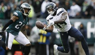 Seattle Seahawks' DK Metcalf (14) cannot hang onto a pass against Philadelphia Eagles' Ronald Darby (21) during the first half of an NFL football game, Sunday, Nov. 24, 2019, in Philadelphia. (AP Photo/Michael Perez)