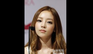 FILE  - In this Tuesday, July 10, 2012 file photo, South Korea's pop girl group KARA's Goo Hara attends a press conference in Singapore. South Korean police say pop star Goo Hara has been found dead at her home in Seoul.Police say an acquaintance found the 28-year-old dead at her home in southern Seoul on Sunday, Nov. 24, 2019 and reported it to authorities. (AP Photo/Wong Maye-E, File)