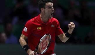 Spain's Roberto Bautista Agut reacts after scoring a point against Canada's Felix Auger-Aliassime during their tennis singles match of the Davis Cup final in Madrid, Spain, Sunday, Nov. 24, 2019. (AP Photo/Manu Fernandez)