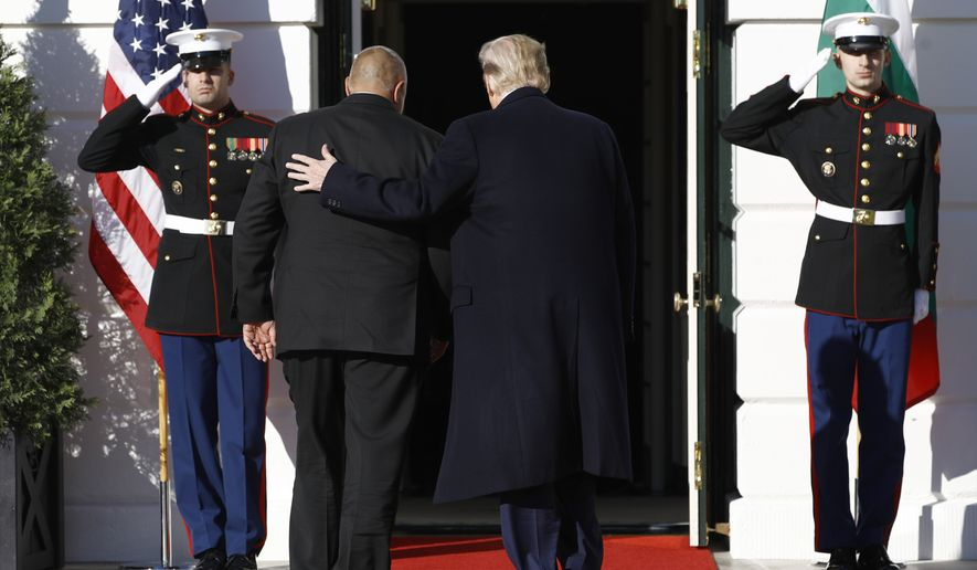 President Donald Trump welcomes Bulgarian Prime Minister Boyko Borissov, left, to the White House, Monday, Nov. 25, 2019, in Washington. (AP Photo/Patrick Semansky)