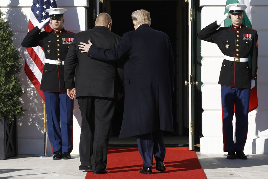 President Donald Trump welcomes Bulgarian Prime Minister Boyko Borissov, left, to the White House, Monday, Nov. 25, 2019, in Washington. (AP Photo/Patrick Semansky)