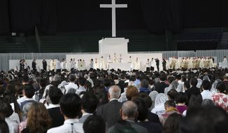 The faithful participate as Pope Francis celebrates Holy Mass at Tokyo Dome Monday, Nov. 25, 2019, in Tokyo. (AP Photo/Eugene Hoshiko)
