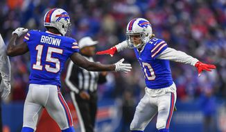 Buffalo Bills wide receiver Cole Beasley (10) celebrates with wide receiver John Brown (15) after scoring a touchdown against the Denver Broncos during the fourth quarter of an NFL football game, Sunday, Nov. 24, 2019, in Orchard Park, N.Y. (AP Photo/Adrian Kraus)