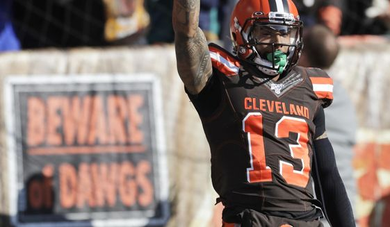 Cleveland Browns wide receiver Odell Beckham Jr. (13) celebrates after a touchdown during the first half of an NFL football game against the Miami Dolphins, Sunday, Nov. 24, 2019, in Cleveland. (AP Photo/Ron Schwane)