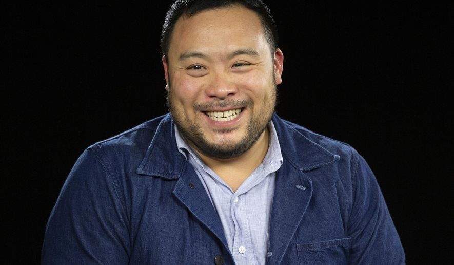 """FILE - This Oct. 23, 2019 photo shows celebrity chef David Chang during an interview in Los Angeles.  Airbnb is launching a global search for 100 top home cooks and treating them to a trip to Italy to learn how to refine their recipes with teachers including David Chang and his mom. he lucky chosen will travel to the University of Gastronomic Sciences in Pollenzo, Italy, for a week's worth of workshops and tastings to take their food """"to the next level."""" Their recipe will also feature in Airbnb's first cookbook. (AP Photo/Damian Dovarganes)"""