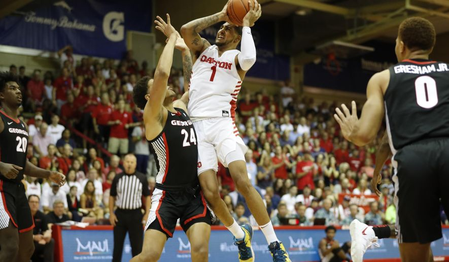 Dayton forward Obi Toppin (1) goes to the basket over Georgia forward Rodney Howard (24) during the first half of an NCAA college basketball game Monday, Nov. 25, 2019, in Lahaina, Hawaii. (AP Photo/Marco Garcia)