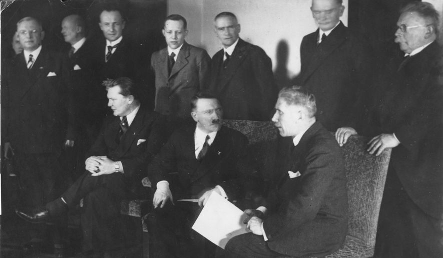 This January 30, 1933 file photo shows the ministers of the new cabinet of Germany's new Chancellor Adolf Hitler in Berlin. Front row from left to right: Hermann Goering, Adolf Hitler, Franz von Papen. Second row standing from right to left are: Alfred Hugenberg, Werner von Blomberg, Wilhelm Frick, Johann Ludwig Graf Schwerin von Krosigk, Paul Freiherr Eltz von Ruebenach and Franz Beldte. A Geneva businessman says he has purchased Adolf Hitler's top hat and other Nazi memorabilia to keep them out of the hands of neo-Nazis and will donate them to a Jewish group. (AP Photo)