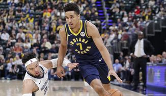 Indiana Pacers guard Malcolm Brogdon (7) drives past Memphis Grizzlies guard Dillon Brooks (24) during the first half of an NBA basketball game in Indianapolis, Monday, Nov. 25, 2019. (AP Photo/Michael Conroy)  **FILE**