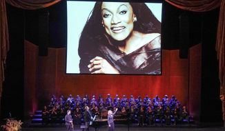 This Nov. 24, 2019 photo released by The Metropolitan Opera shows soprano Renée Fleming, foreground center, violinist David Chan, foreground left, and pianist Gerald Martin Moore during a memorial for Jessye Norman at The Metropolitan Opera in New York. Norman died Sept. 30 at age 74. (Richard Termine/The Metropolitan Opera via AP)
