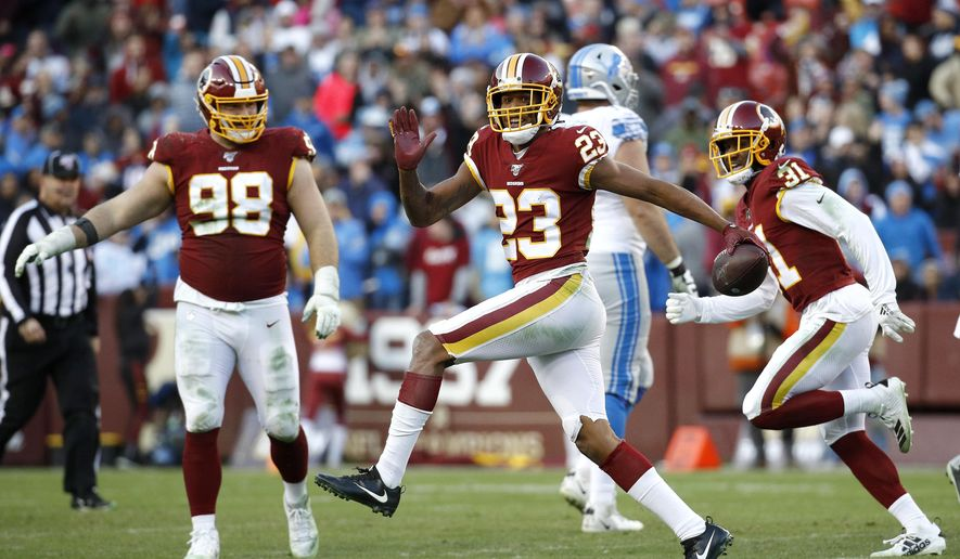 Washington Redskins cornerback Quinton Dunbar (23) reacts after intercepting a pass from Detroit Lions quarterback Jeff Driskel during the second half of an NFL football game, Sunday, Nov. 24, 2019, in Landover, Md. The Redskins won 19-16. (AP Photo/Patrick Semansky)