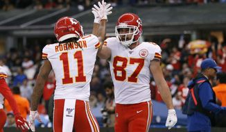 Kansas City Chiefs tight end Travis Kelce, right, celebrates with teammate wide receiver Demarcus Robinson after scoring a touchdown during the second half of an NFL football game against the Los Angeles Chargers, Monday, Nov. 18, 2019, in Mexico City. (AP Photo/Rebecca Blackwell)