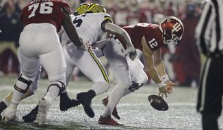 Indiana quarterback Peyton Ramsey (12) tries to recover a fumble after being hit by Michigan linebacker Josh Uche (6) during the second half of an NCAA college football game, Saturday, Nov. 23, 2019, in Bloomington, Ind. Michigan won 39-14. (AP Photo/Darron Cummings)