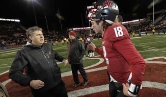 Washington State quarterback Anthony Gordon, right, moves to hug coach Mike Leach after the team's 54-53 win over Oregon State in an NCAA college football game, Saturday, Nov. 23, 2019, in Pullman, Wash. (AP Photo/Ted S. Warren)