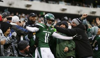 New York Jets wide receiver Robby Anderson (11) celebrates with fans after scoring a touchdown during the second half of an NFL football game against the Oakland Raiders Sunday, Nov. 24, 2019, in East Rutherford, N.J. The Jets won 34-3. (AP Photo/Adam Hunger)