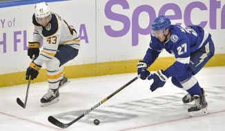 Tampa Bay Lightning defenseman Ryan McDonagh (27) clears the puck away from Buffalo Sabres' Conor Sheary (43) during the second period of an NHL hockey game Monday, Nov. 25, 2019, in Tampa, Fla. (AP Photo/Steve Nesius)
