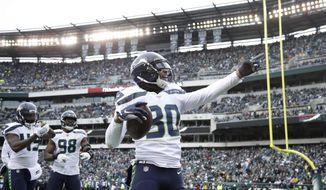 Seattle Seahawks' Bradley McDougald (30) celebrates after intercepting a Philadelphia Eagles' pass during the first half of an NFL football game, Sunday, Nov. 24, 2019, in Philadelphia. (AP Photo/Matt Rourke)