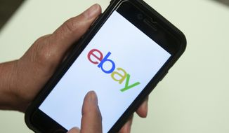 FILE - In this July 11, 2019, file photo, an Ebay app is shown on a mobile phone in Miami. EBay is selling StubHub to ticket seller viagogo for $4.5 billion. (AP Photo/Wilfredo Lee, File)