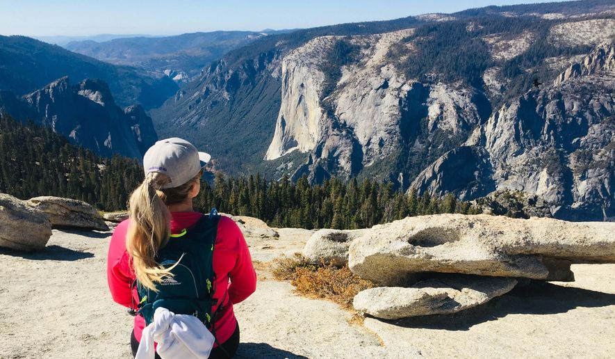 This Oct. 20, 2019, file photo shows Karen Tara, of San Francisco, soaking in the views of El Capitan from the top of Sentinel Dome in Yosemite National Park. (AP Photo/Amanda Lee Myers) ** FILE **