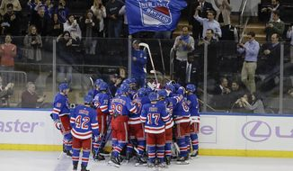 The New York Rangers celebrate a game winning goal by Tony DeAngelo during the overtime period of an NHL hockey game against the Minnesota Wild Monday, Nov. 25, 2019, in New York. The Rangers won 3-2. (AP Photo/Frank Franklin II)