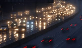 Motorists drive in the rain north, top, on Interstate 270 in Rockville, Md., out of Washington, Tuesday, Nov. 26, 2013. (AP Photo/Charles Dharapak)