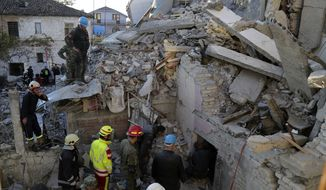 Rescuers try to free a man from a collapsed building after a magnitude 6.4 earthquake in Thumane, western Albania, Tuesday, Nov. 26, 2019. Rescue crews with excavators searched for survivors trapped in toppled apartment buildings and hotels Tuesday after a powerful pre-dawn earthquake in Albania killed at least 18 people and injured more than 600. (AP Photo/Visar Kryeziu)
