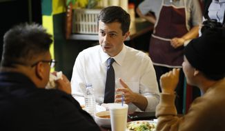 Democratic presidential candidate South Bend, Ind., Mayor Pete Buttigieg eats lunch with with local residents, Tuesday, Nov. 26, 2019, in Denison, Iowa. (AP Photo/Charlie Neibergall) ** FILE **