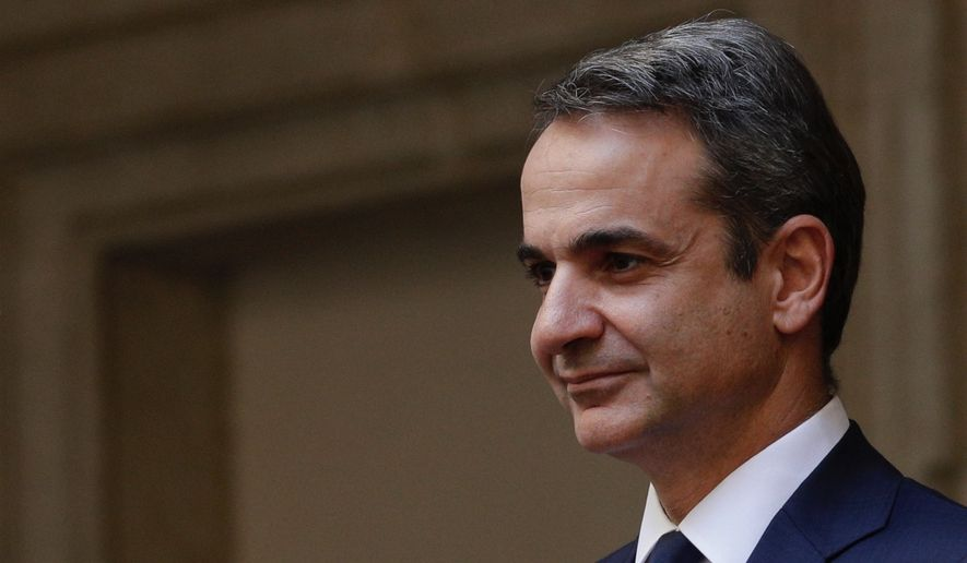 Greek Prime Minister Kyriakos Mitsotakis arrives for a meeting with Italian Premier Giuseppe Conte at Chigi Palace premier's office, in Rome, Tuesday, Nov. 26, 2019. (AP Photo/Andrew Medichini)