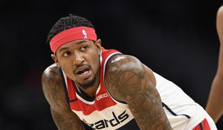 Washington Wizards guard Bradley Beal (3) stands on the court during the first half of an NBA basketball game against the Sacramento Kings, Sunday, Nov. 24, 2019, in Washington. (AP Photo/Nick Wass)