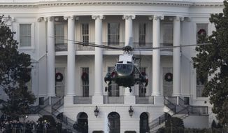 Marine One, with President Donald Trump aboard, lifts off from the the South Lawn of the White House, Tuesday, Nov. 26, 2019, in Washington. (AP Photo/Alex Brandon)