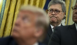Attorney General William Barr listens as President Donald Trump speaks during an event to sign an executive order establishing the Task Force on Missing and Murdered American Indians and Alaska Natives, in the Oval Office of the White House, Tuesday, Nov. 26, 2019, in Washington. (AP Photo/ Evan Vucci)